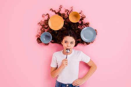 Top view above high angle flat lay flatlay lie concept portrait of her she, nice attractive beautiful wavy-haired girl licking spoon dishes meal isolated over pink pastel color background