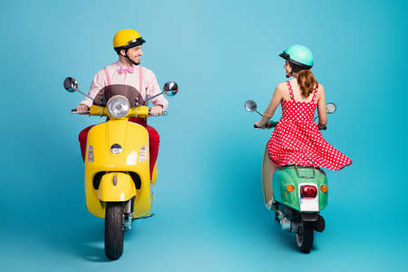Full size back rear spine photo of positive man ride motor bike chopper look pretty coquettish flirty redhair girl motorcyclist want have date isolated over blue color background