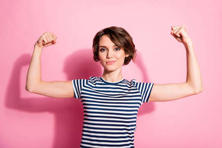 Portrait of successful strong girl bodybuilding trainer demonstrate her power muscles wear good look outfit isolated over pastel color background