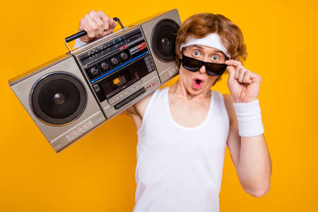 Close-up portrait of his he nice attractive cool amazed foxy ginger guy carrying boombox omg incredible news pout lips expression isolated over bright vivid shine vibrant yellow color background