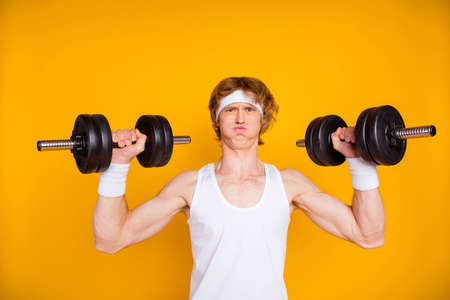Close-up portrait of his he nice attractive sportive funky motivated guy sportsman lifting heavy barbell doing work out fat burn isolated over bright vivid shine vibrant yellow color background