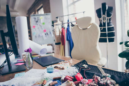 Light white room flat apartment needlewomen doing making order production, personal branding glamour couture different color type nobody chair with necklace work workplace station indoors Фото со стока