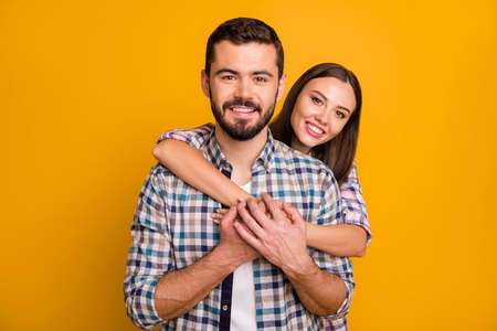 Portrait of tender gentle man woman spouses couple hug embrace cuddle piggyback enjoy rest relax valentine day date together wear plaid clothes isolated over bright shine color background