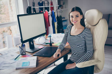Portrait of her she nice attractive pretty cheerful cheery professional successful seamstress needlewomen expert making creating new order dress at workplace workstation