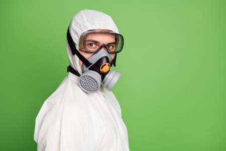 Close-up profile side view portrait of his he nice serious expert workman doc wearing gas mask clean sterile costume sars ncov n-cov-2 first aid defense isolated over green pastel color background