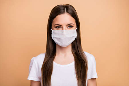 Close-up portrait of her she nice attractive charming lovely healthy long-haired girl wearing gauze cotton mask sickness illness disease prevention isolated over beige pastel color background