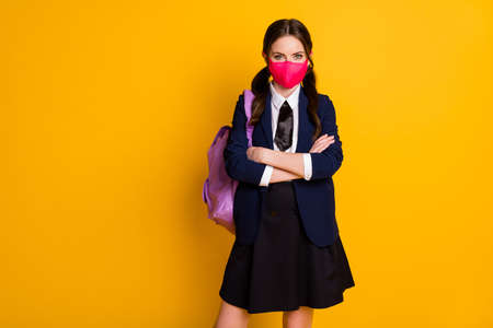 Portrait of her she nice attractive pretty lovely content brown-haired schoolgirl wearing pink mask folded arms isolated on bright vivid shine vibrant yellow color background