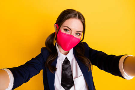 Self-portrait of her she nice attractive cute pretty lovely trendy brown-haired schoolgirl wearing pink mask quarantine health isolated on bright vivid shine vibrant yellow color background Stock Photo - 148290446
