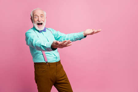 Photo of funky crazy amazed grandpa hold hands raised up catch throw air falling novelty low price product wear specs mint shirt suspenders bow tie pants isolated pink pastel color background