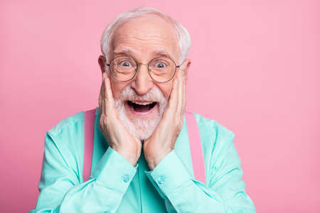 Closeup photo of funky crazy grandpa hands on cheeks look discount low shopping prices wear specs mint shirt suspenders bow tie isolated bright pink pastel color background