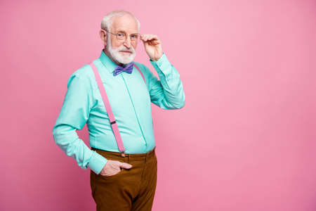 I can see you well. Photo of amazing stylish look grandpa look intelligent candid clever eyes wear specs mint shirt suspenders violet bow tie pants isolated pastel pink color background