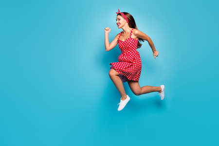 Full length body size view of her she nice-looking attractive lovely purposeful cheerful cheery straight-haired girl jumping running fast isolated on bright vivid shine vibrant blue color background