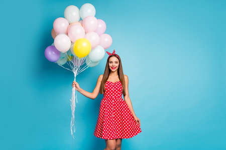 Portrait of her she nice-looking attractive lovely pretty cute straight-haired girl holding bunch air balls delivery festal day isolated on bright vivid shine vibrant blue color background
