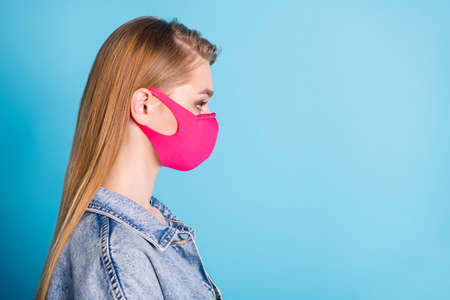 Closeup profile photo of pretty lady social distance concept not contact people responsible citizen serious expression wear protect face mask denim blazer isolated blue color background