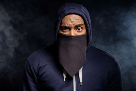 Close up photo of amazed afro american guy impressed african community discrimination ear bandanna sweater jumper isolated over black fog color background