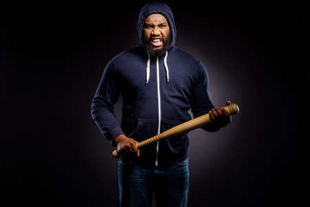 Photo of furious afro amercan guy hold baseball beat ready fight for african community solidarity rights wear sweater jumper denim jeans isolated black color background