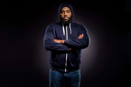 Photo of afro american guy anti racism activist cross hands wear sweater isolated over black color background Imagens