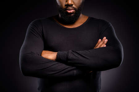 Cropped photo of serious afro american guy, cross hands ready fight for human equality isolated over black color background