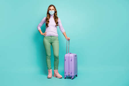 Full length body size view of her she slim pretty girl wearing safety gauze mask departing abroad risk ncov-2 cov mers respiratory prevention isolated green blue teal turquoise color background