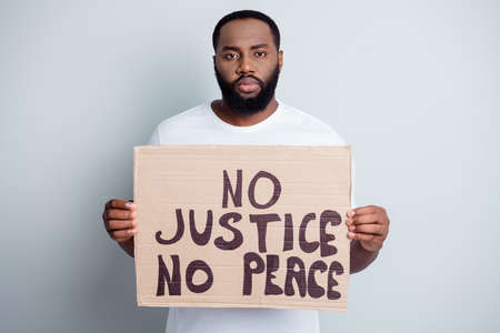 Black lives matter concept. Photo of serious disappointed dark skin african, protester placard community against black citizens lawlessness stop murder people isolated grey color background