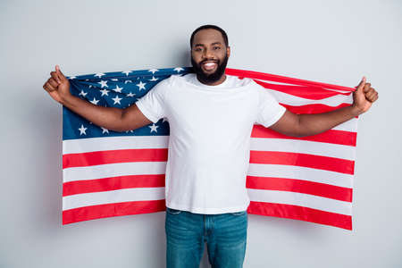 Photo of cheerful friendly dark skin african guy protester raise american national flag black people revolution love all human beings express unity solidarity isolated grey color background