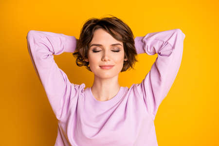 Close-up portrait of her she nice attractive lovely cute pretty lovable sweet dreamy girl resting free time closed eyes isolated on bright vivid shine vibrant yellow color background