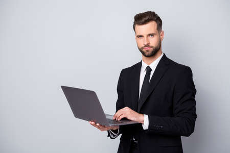 Portrait of serious confident cool entrepreneur man work with computer deal with start-up information clients wear classy outfit isolated over grey color background