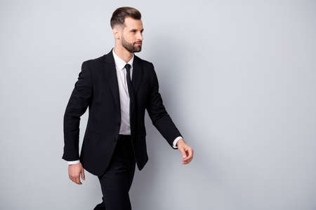 Profile side photo of masculine charismatic worker go walk on business partners meeting wear formalwear pants trousers isolated over grey color background Stock fotó