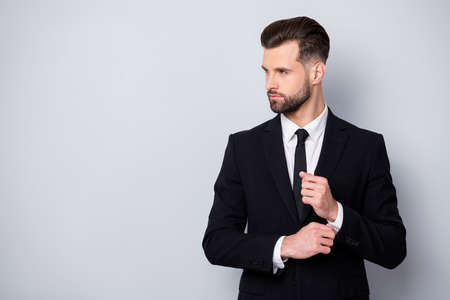 Profile side photo of charismatic serious worker man adjust cufflinks look copyspace prepare for business meeting wear classy clothes isolated over grey color background