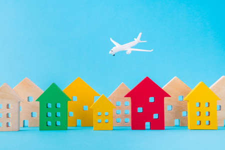 Art design picture of nice wooden figures settlement city residence economy development plane flying isolated over bright vivid shine vibrant blue color background