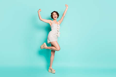Full length body size view of her she nice attractive lovely charming cheerful cheery girl having fun dancing celebrating day holiday party isolated on bright vivid shine vibrant blue color background