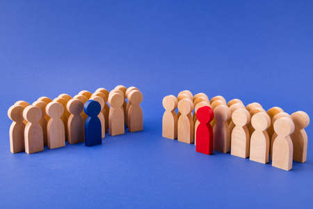 Two groups of wooden figures members participants standing behind their leaders team unity gathering deal agreement isolated over bright vivid shine vibrant blue color background Foto de archivo