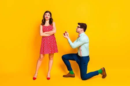 Full length photo frustrated geek man propose give ring girl cross hands indifferent wear red dotted dress mini short legs suspenders shirt trousers isolated bright shine color background