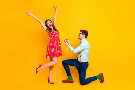 I say yes. Full body profile photo of pretty lady handsome guy proposing girlfriend stand knee hold diamond ring box wear red dress shirt bowtie isolated yellow bright color background