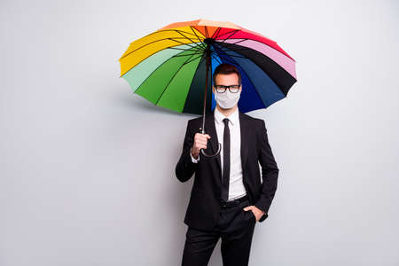 Portrait of his he executive healthy guy employee wearing safety mask holding umbrella news cov mers pandemia visit office social distance lgbt isolated grey color background Foto de archivo - 150060242