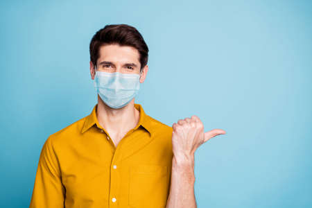 Close-up portrait of his he nice confident healthy guy wearing safety mask demonstrating copy empty blank space place mers cov pneumonia china wuhan isolated pastel color background