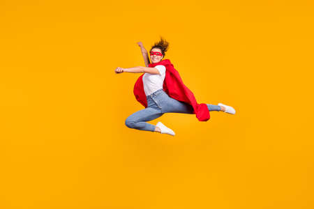 Full length body size view of her she nice attractive lovely fit slim cheerful cheery girl jumping wearing cape rescuing planet isolated on bright vivid shine vibrant yellow color background