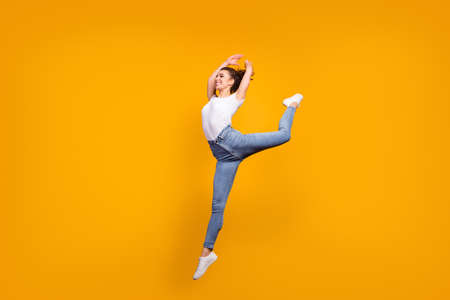 Full length body size view of her she nice attractive slender thin perfect graceful healthy cheerful girl jumping dancing isolated on bright vivid shine vibrant yellow color background Imagens