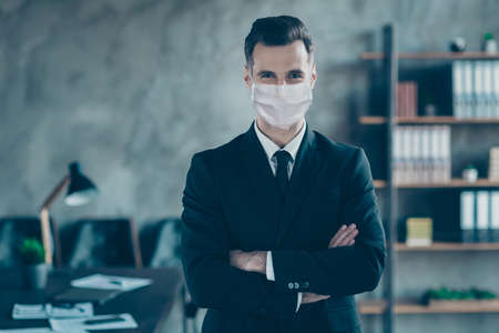 Portrait of his he of nice executive ceo boss chief guy top director folded arms wearing safety mask stop flu flue grippe contamination influenza at modern industrial loft work place station