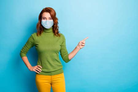 Portrait of her she nice healthy girl wearing safety mask demonstrating copy space contamination infection influenza stop pandemia isolated bright vivid shine vibrant green blue color background