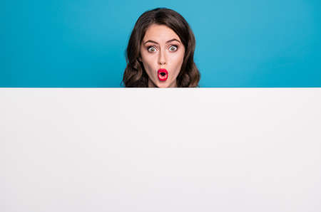 Closeup photo of pretty funny crazy lady open mouth read empty advertisement banner novelty surprise placard shocked facial expression isolated blue color background Zdjęcie Seryjne