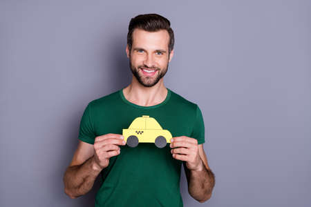 Portrait of cheerful confident guy hold hand paper card car enjoy taxi service on spring time tourism weekend rest relax wear trendy clothes isolated over gray color background