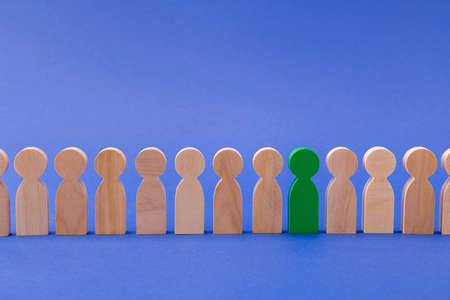 Row line of wooden figures people standing. HR manager choosing one special guy talented person among ordinary candidates isolated over bright vivid shine vibrant blue color background