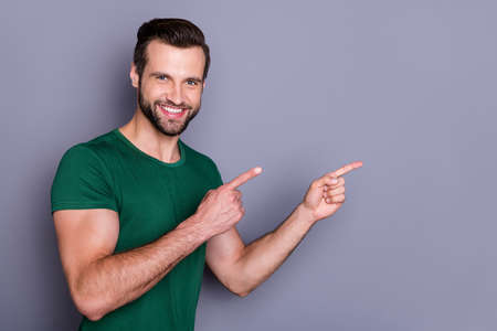 Portrait of positive guy promoter point index finger copyspace indicate discount adverts promo suggest select wear good look outfit isolated over gray color background