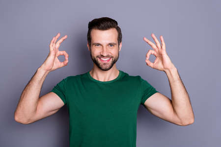Portrait of positive confident guy promoter show double okay sign enjoy excellent sales adverts promotion wear good look outfit isolated over gray color background Archivio Fotografico - 150590411