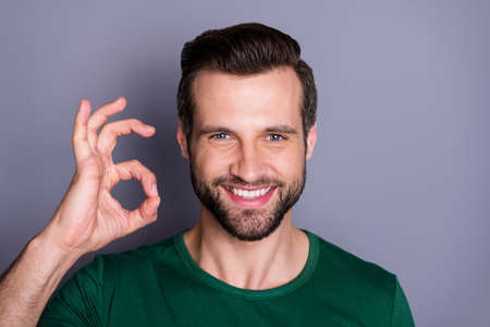 Close up photo of positive cheerful guy promoter show okay sign indicate great ads wear good look clothes isolated over gray color background Archivio Fotografico - 150590412