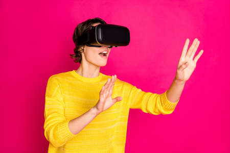 Portrait of positive cheerful youth teen girl have vr-box play virtual reality, game search cyberspace wear style stylish trendy yellow jumper isolated over bright shine color background