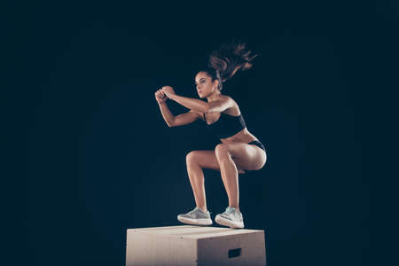 Portrait of her she nice attractive concentrated sportive strong slim thin lady working out body sculpt weight loss program lifestyle isolated over black background