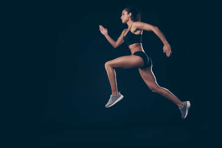 Full size profile photo short sport suit lady sprint run jogger inspired to win race first place member isolated black background Stockfoto