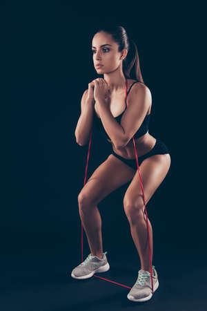 Full body photo of focused serious sportive millennial limber-up ass buttocks isolated over black background Stock Photo